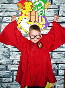 Boy dressed as Harry Potter at birthday party