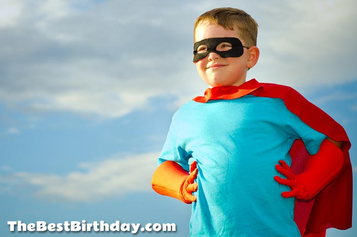 Young superhero child pretending to be superman for a party